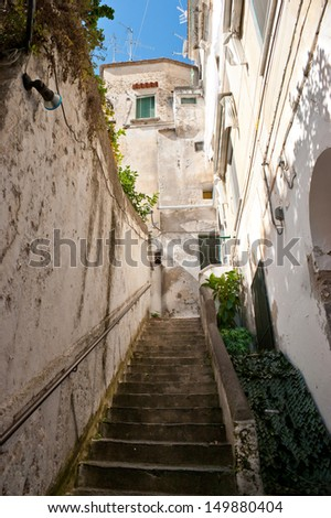 The medieval street of Amalfi with narrow staircase, Italy. - stock photo