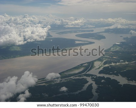 The Meeting of Waters (Portuguese: Encontro das Aguas) is the confluence between the Rio Negro, a river with dark (almost black coloured) water, and the sandy-coloured Amazon River or Rio Solimoes - stock photo