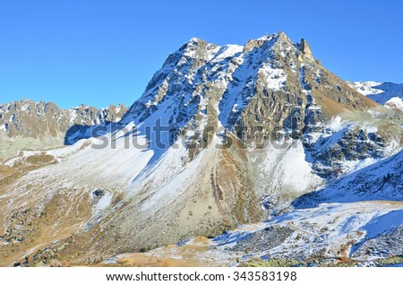 The Meidspitz in the southern swiss Alps above Sierre, with a dusting of autumnal snow - stock photo