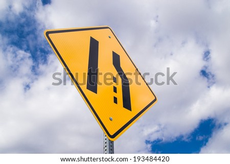 The merge left sign. - stock photo