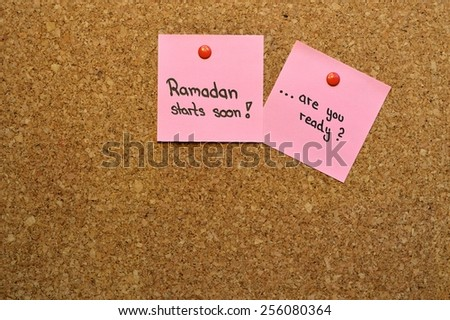 "The message ""Ramadan starts soon...are you ready?"" on a pin board"