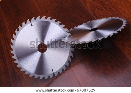 The metal disc is a circular saw on a dark background