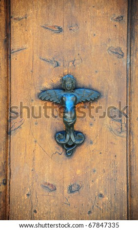 The Metal Door Handle In The Form Of The Angel - stock photo
