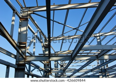 The metal frame of the building under construction.