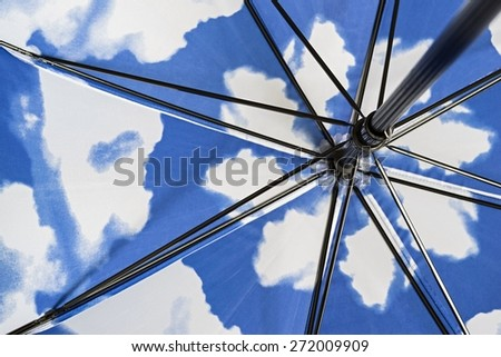 The Metal Internal Mechanism Of A Folding Umbrella Closeup Against A Spotty  Surface Of Blue White