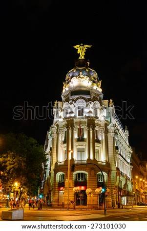 The Metropolis Building (Edificio Metropolis) at the corner of the Calle de Alcala and the Gran Via in Madrid at evening in Spain. Madrid is a popular tourist destination of Europe. - stock photo