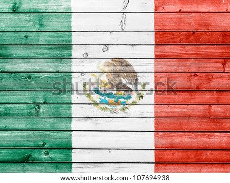 The Mexican flag painted on wooden fence - stock photo