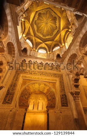 The Mezquita also features richly gilded prayer niches. But the Mezquita's most interesting feature is certainly the mihrab, a domed shrine of Byzantine mosaics built by Al Hakam II (961-76). I - stock photo