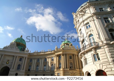 The Michaelertrakt of the Hofburg in Vienna, Austria. View from the Michaelerplatz. - stock photo