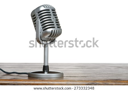 The microphone on the table with isolated background - stock photo