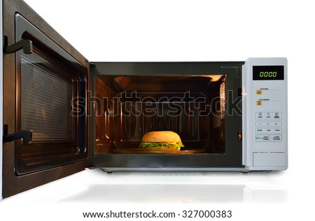 The microwave oven is warm pork / chicken burger with cheese.