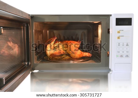 The microwave oven is warm roasted chicken with black pepper on white background.