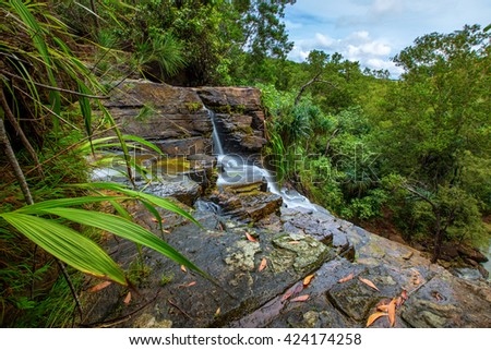 The mid point of Tarzan Falls on the island of Guam, USA.  Looks out over central Guam.