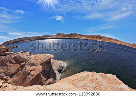 The midday sun in the turquoise water bay. Bottling magnificent Lake Powell photographed by Fisheye lens - stock photo