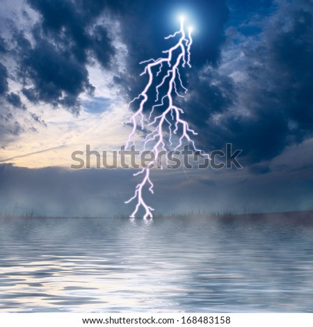 The middle of the ocean at storm with lightnings  - stock photo