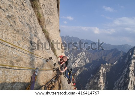 The mighty Mount Huashan`s plank walk in the sky in Shanxi province, central China