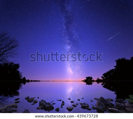 The Milky Way and a perseid meteor Over Salt Fork Lake, Ohio - stock photo