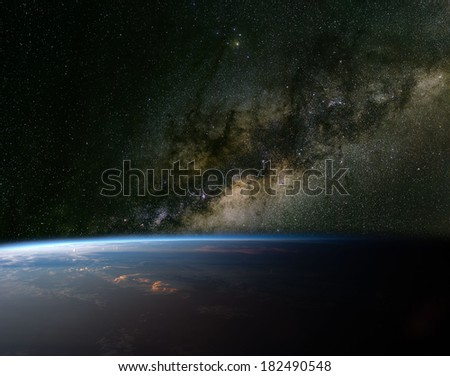 The Milky Way over planet Earth. Elements of this image furnished by NASA.  - stock photo