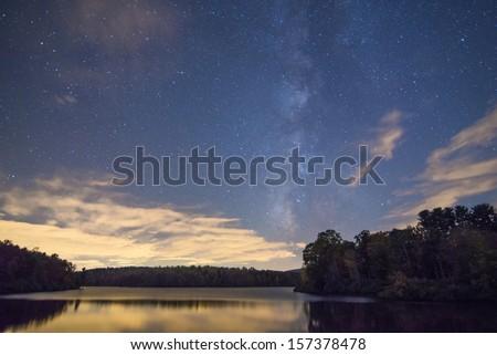 The Milky Way over the Julian Price Lake near Blowing Rock, North Carolina - stock photo