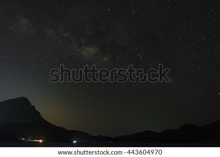 The Milky Way over the mountains. Long exposure photograph. - stock photo