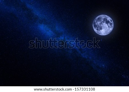 The milky way with the moon in blue color - stock photo