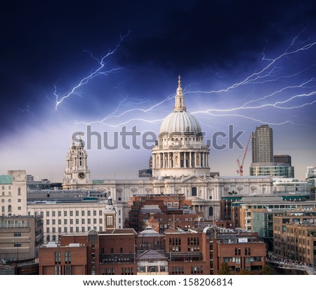The Millennium Bridge and St Paul Cathedral. Bad weather in London. - stock photo