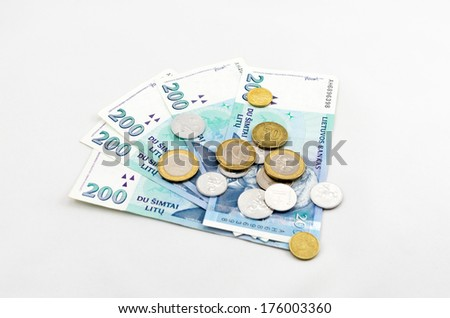 The minimum wage in Lithuania. Several banknotes and coins.