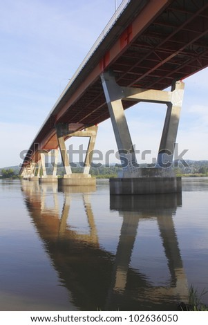 The Mission Bridge, a main spanway connecting British Columbia's Fraser Valley with the Northshore/The Mission Bridge/Mission Bridge across the Fraser River - stock photo