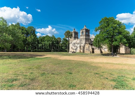 The Mission Concepcion - San Antonio Missions National Historical Park under blue cloud sky. It is the oldest unrestored stone church in America and one of the top attractions in San Antonio, Texas.
