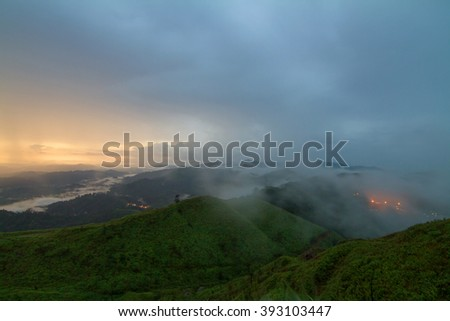 The mist and sunlight at the mountain in the morning time