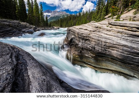 The Mistaya River becomes Mistaya Canyon, Banff National Park, Alberta. - stock photo