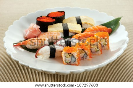 The mix sushi of salmon, eggs, prawn, and others. - stock photo