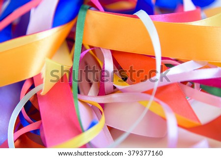 The mixed colored satin ribbons. background from colorful ribbon