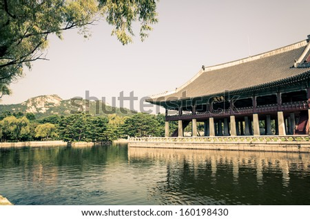 The moat that surrounds one of the pavilions at Gyeonbokgung Palace in Seoul, South Korea. The palace is the largest of the five grand palaces built by the Joseon Dynasty. - stock photo
