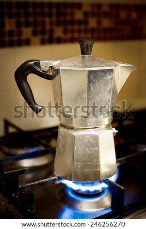 The mocha coffee pot on the stove for  Italian coffe - stock photo