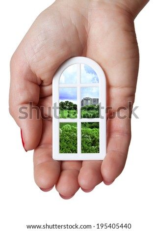 The model is beautiful plastic Windows in hand with views of the city skyline - stock photo