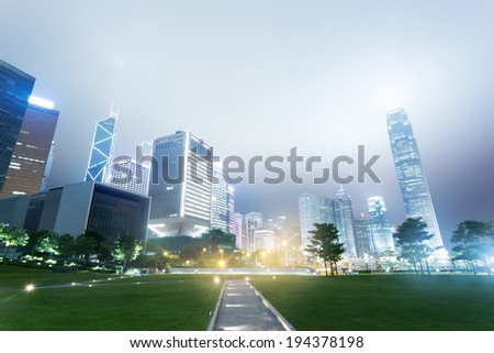 The modern buildings and city park - stock photo
