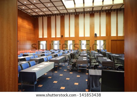 The modern conference room with chairs and tables
