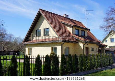 The modern house on a background of sky - stock photo