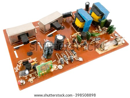 The modern printed-circuit board with electronic components - stock photo