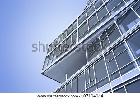 The modern skyscraper on a background sky - stock photo