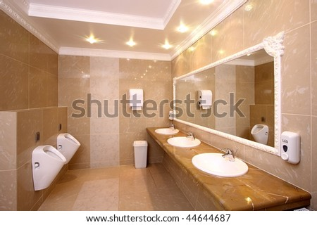 The modern toilet room finished with a tile - stock photo