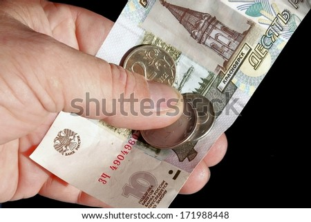 The money clamped in a palm - stock photo