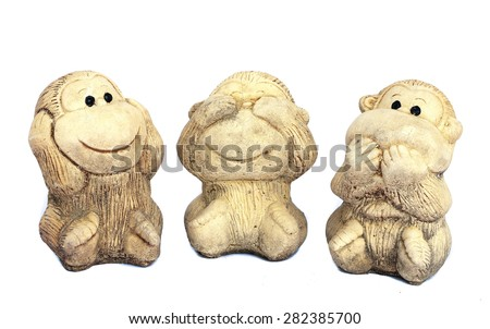 the monkey dolls are molded using hand action close ears,eyes and mouth on white background - stock photo