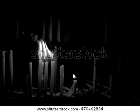The monochrome of candles and flame