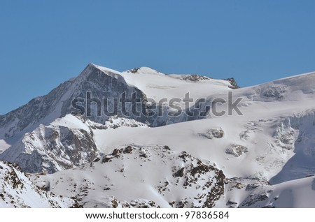 The mont Blanc de Cheilon with ski tracks visible, a high mountain popular with climbers and ski mountaineers in the southern swiss alps near to Arolla