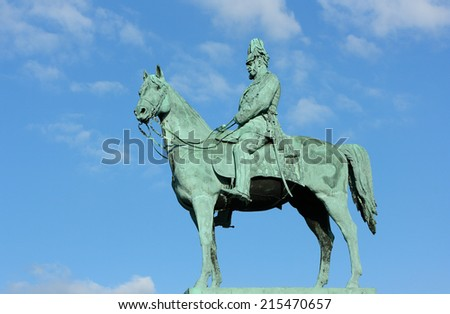 The monument of Emperor Wilhelm I. Figure of the Emperor Wilhelm I on a horse on a background of blue sky. Monument is located near the City hall Hamburg-Altona.