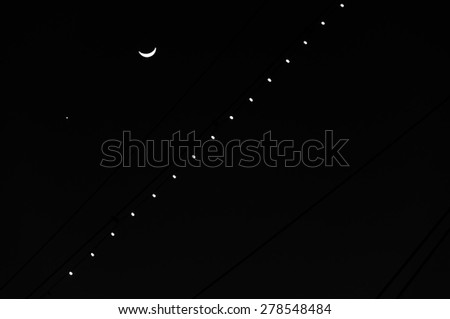 The Moon and Venus, silhouetted with the masts of the USS Constellation, at the Inner Harbor in Baltimore, Maryland