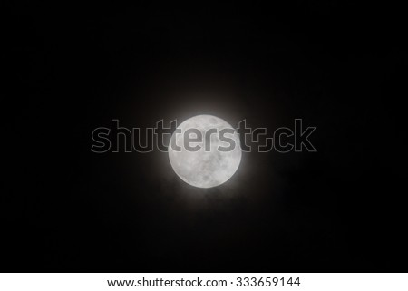 The moon in dark night. blur effect added , soft color - stock photo