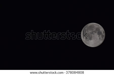 The moon in the night sky. Two thirds of the moon.